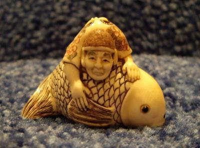 Старец Цинь-Гао плывет на карпе