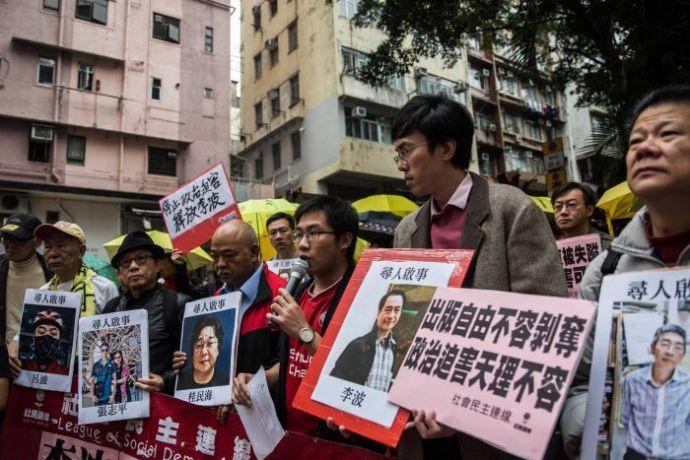 Демонстрации, связанные с пропажей издателей в Гонконге. Фото: www.abc.net.au