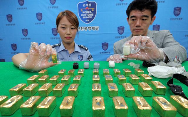 Китайская таможня задержала иностранца пытавшегося вывезти полкило золота в анусе