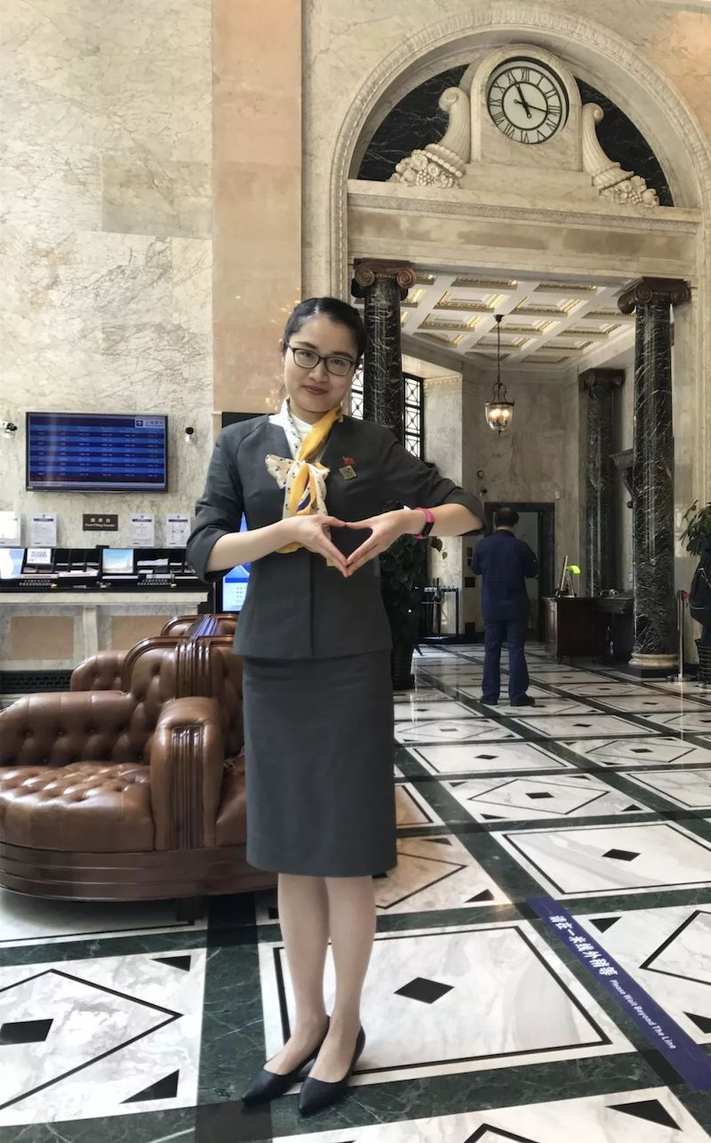 Сотрудница Банка Шанхая любит свою работу в старом здании. Источник: sohu.com